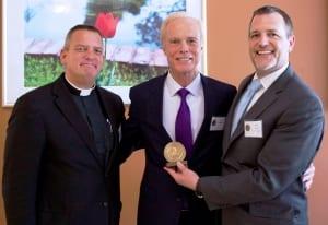 Wartburg Board Member Rev. Eric O. Olsen, Dr. Jay Passavant, Wartburg President & CEO David J. Gentner